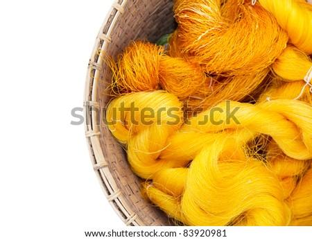 Hand made raw silk thread in Basket. - stock photo
