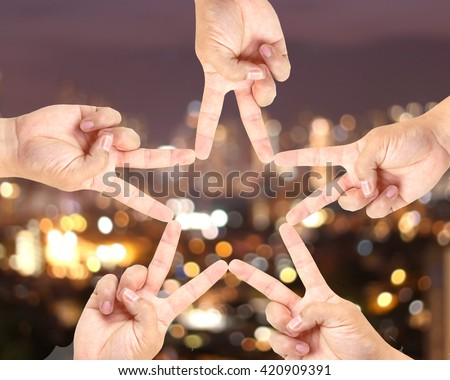 Hand-made star symbol blurred Bokeh City Earth background. The image conveyed to dream big. Imagination meaningful victory. Photo abstract background. Elements of this image furnished by NASA.Concept - stock photo