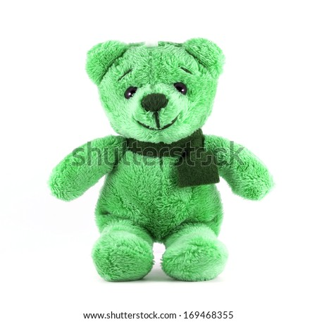 Hand made TEDDY BEAR green color with scarf on white background - stock photo