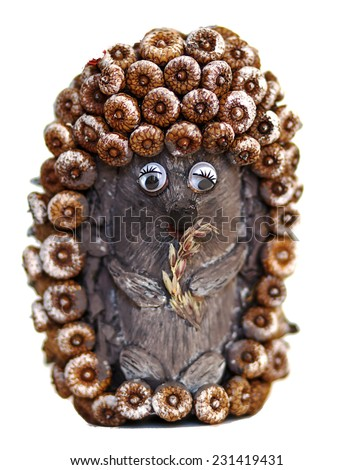 hand made toy  hedgehog from acorns  - stock photo