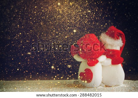 Hand made toy snowmans - stock photo