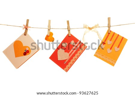hand made valentine's cards on a string - stock photo