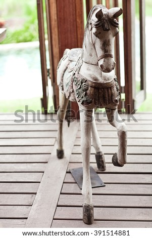 Hand made wooden vintage white horse standing on the wood floor