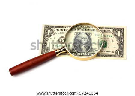 hand magnifier over banknote isolated on white background - stock photo