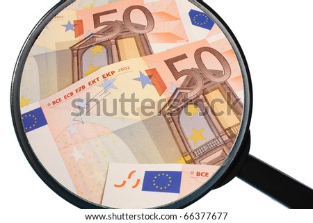 hand magnifier over euro banknote isolated on white background - stock photo