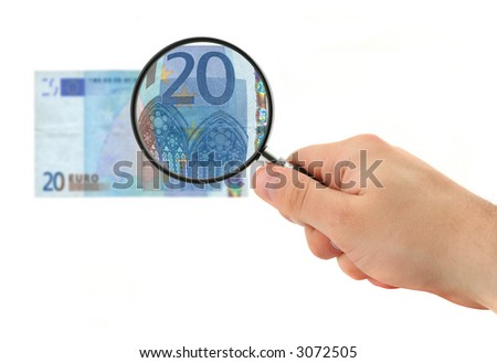 hand magnifying 20 Euro note isolated on white
