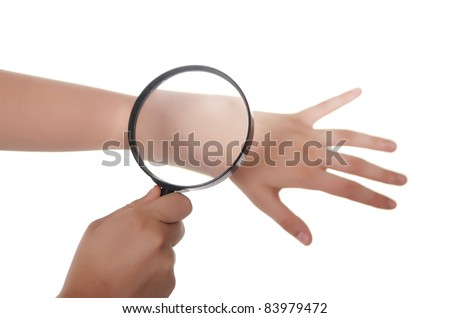 hand, magnifying glass and skin - stock photo