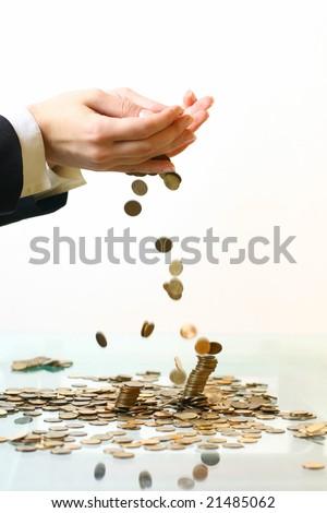 hand make coins rain - stock photo