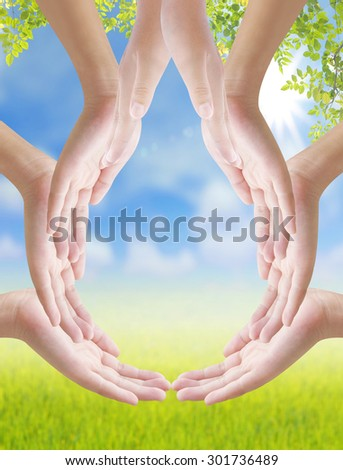 Hand make drop of water shape on nature background, concept design