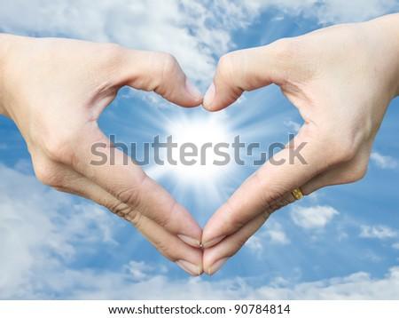 Hand make heart sign - stock photo