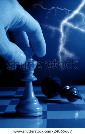 hand making a decisive and winning chess move - stock photo