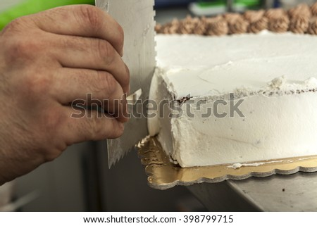 Hand making a delicious sweet cake foe me