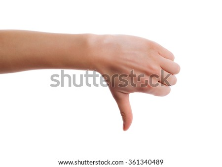 Hand making a thumbs down gesture. Image of human hand showing thumb down in isolation