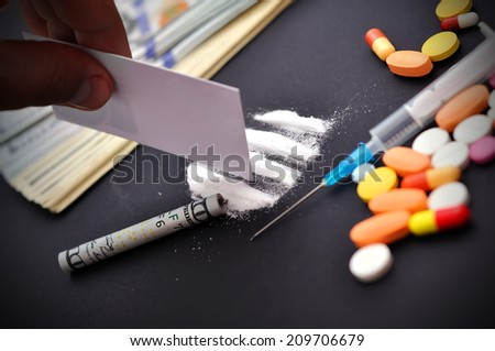hand making a track from cocaine - stock photo