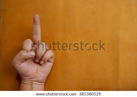 hand making gesture on the leather background selective focus - stock photo