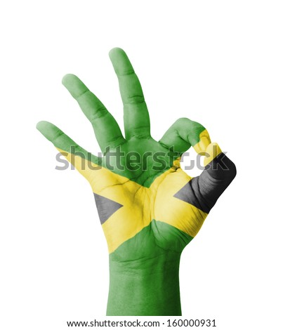 Hand making Ok sign, Jamaica flag painted as symbol of best quality, positivity and success - isolated on white background - stock photo