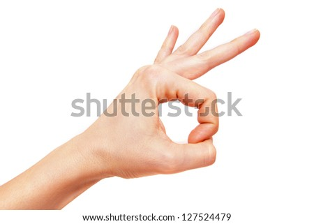 Hand making the OK sign isolated on white background. - stock photo