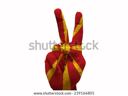 Hand making the V sign country flag painted macedonia - stock photo