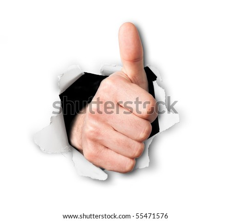 Hand making thumbs up sign breaking through a thin wall or paper, isolated on white - stock photo