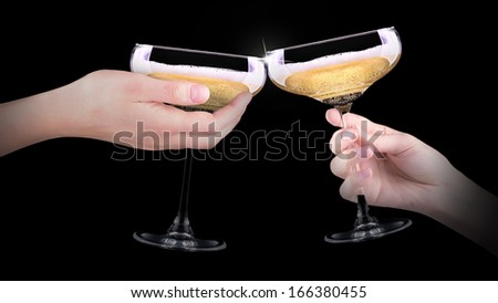 hand making toast with champagne glass on black background