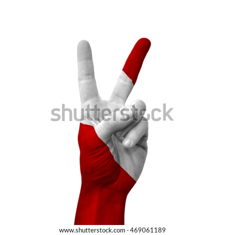 Hand making victory sign, peru painted with flag as symbol of victory, win, success - isolated on white background