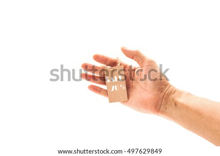 hand male holding small brown tag,price tag, sale tag 70 % isolated on white background