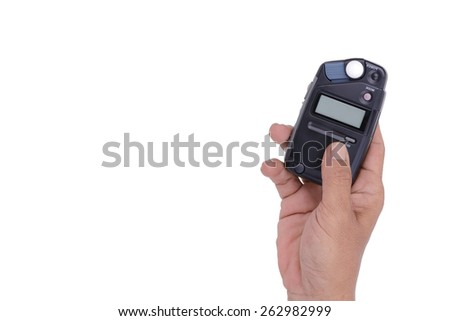 hand male with professional light metering or photometer tool, digital flash-meter, isolated on white background