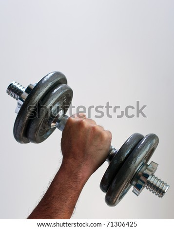 hand man and heavy dumbbell - stock photo