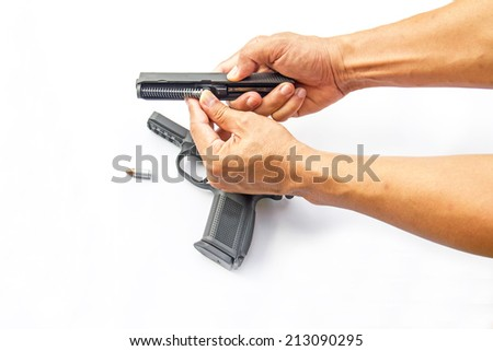 Hand man with gun. Gun and ammo isolated on white  - stock photo