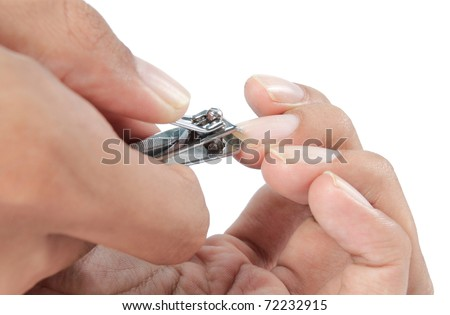 hand manicure with nail clipper. close up over white background - stock photo