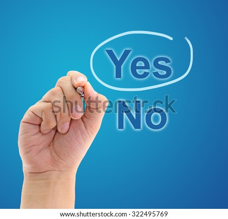 Hand mark on Yes with blue pen, business concept - stock photo
