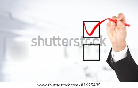 Hand marking one option. White background. - stock photo