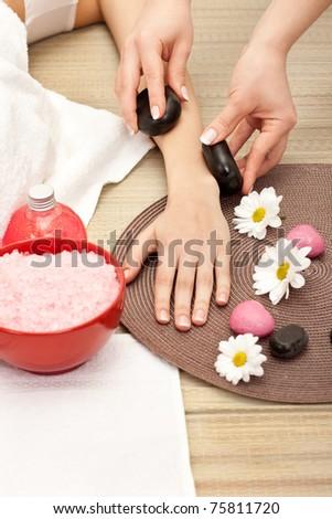 hand massage at the spa salon - stock photo