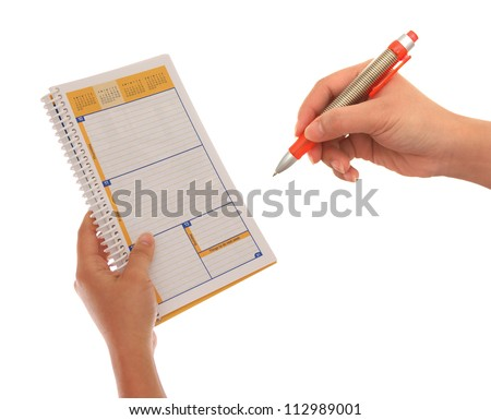hand, notebook, and pen on white background