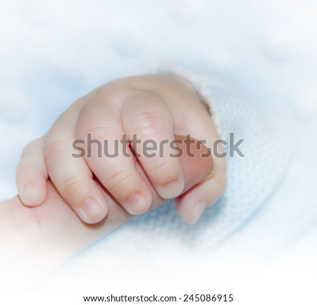 hand of a baby - stock photo