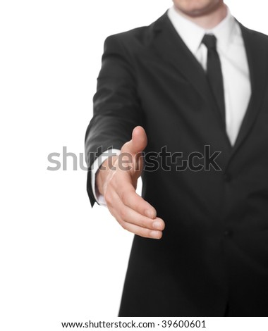 Hand of a businessman ready for handshake - stock photo