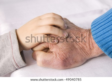 hand of a child and grandfather - stock photo