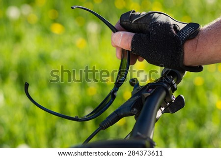 Hand of a cyclist at the brake
