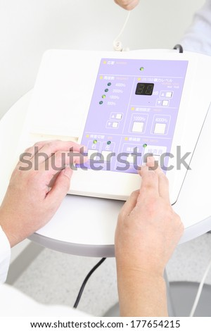 Hand of a doctor conducting hearing test