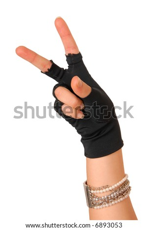 "hand of a girl in black glove is showing sign that means ""hey"" - stock photo"