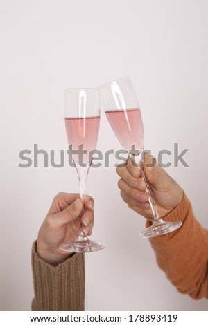 Hand of a Japanese couple to toast with champagne