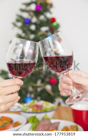 Hand of a Japanese couple toasting with wine