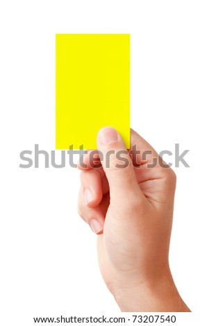 Hand of a judge showing warning symbol - yellow card, isolated on white background - stock photo