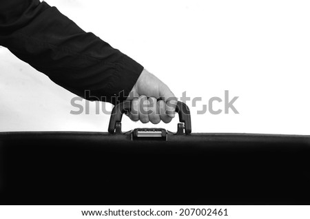 Hand of a man carry travel suitcase against white background with copy space. Concept photo of travel, vacation, holiday, destination, tourism, traveler, tourist. (BW) - stock photo