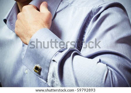 hand of a man in a shirt - stock photo