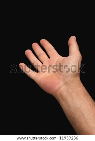 Hand of a man reaching out, set against a black background.
