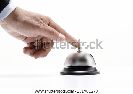 Hand of a man using a hotel bell isolated on white background - stock photo