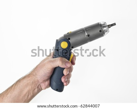 hand of a man who works with an electric screwdriver