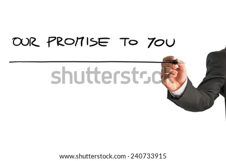 Hand of a man writing Our promise to you on a virtual screen or interface with a marker pen with copyspace below. - stock photo