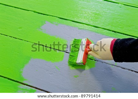 hand of a painter with brush and paint - stock photo